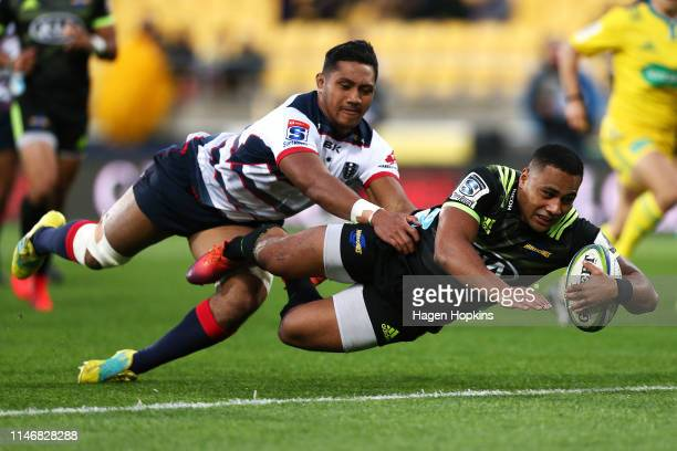 Ngani Laumape of the Hurricanes scores a try in the tackle of Rob Leota of the Rebels during the round 12 Super Rugby match between the Hurricanes...