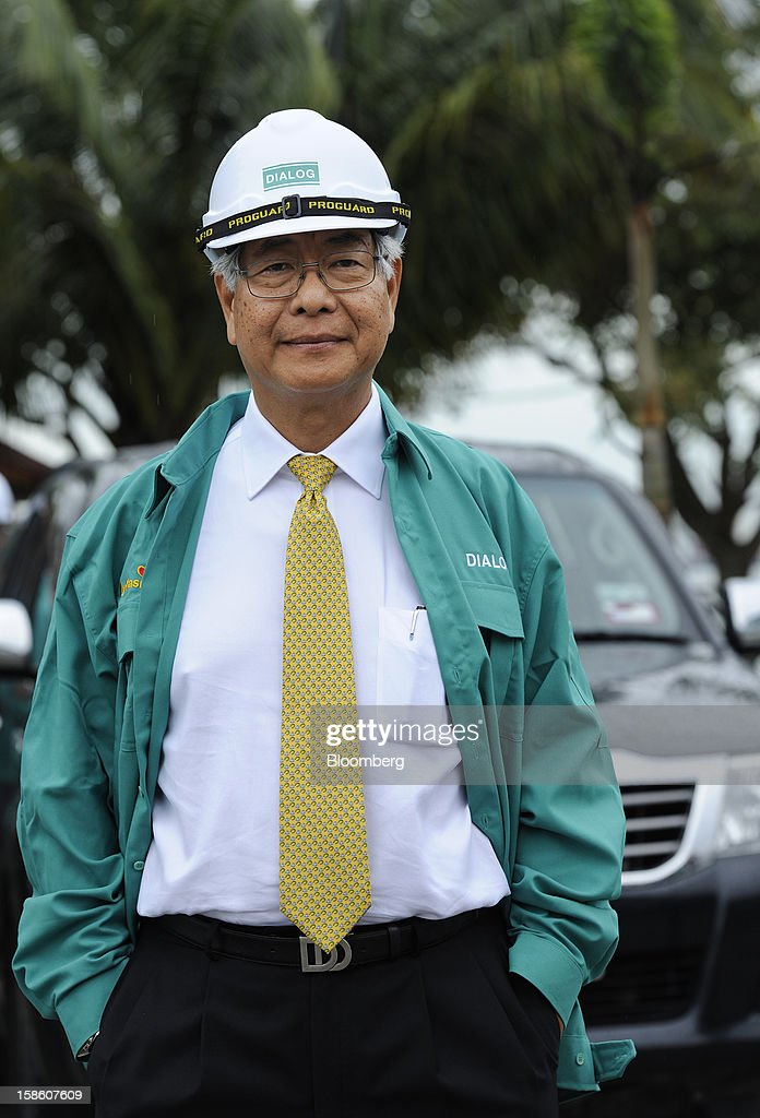Ngau Boon Keat, managing director of Dialog Group Bhd., stands for a portrait in Pengerang, Johor, Malaysia, on Tuesday, Dec. 18, 2012. Dialog, Malaysia's second-biggest oil and gas services provider, said it signed some customers for the 1.9 billion-ringgit ($620 million) storage terminal it's developing with Royal Vopak NV. Photographer: Munshi Ahmed/Bloomberg via Getty Images