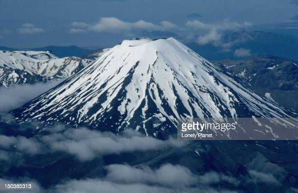 Ngauruhoe (7515ft or 2291m) is a beautifully shaped volcano on the edge of the Tongariro massif. Ngauruhoe is New Zealand's most active volcano with 61 eruptions since 1839.
