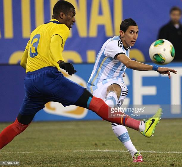 ��ngel Di Mar��a Argentina shoots past Frickson Erazo Ecuador during the Argentina Vs Ecuador International friendly football match at MetLife...