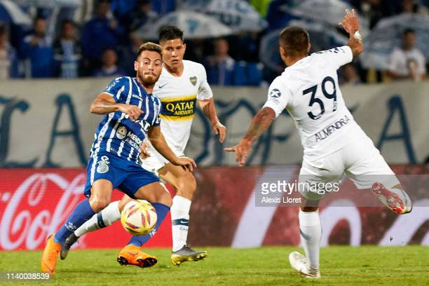 Ángel González of Godoy Cruz competes for the ball with Agustín Almendra of Boca Juniors during a first leg round of sixteen match between of Godoy...