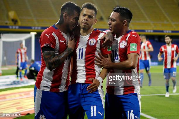 Ángel Romero of Paraguay celebrates after scoring the first goal of his team with teammates during a match between Argentina and Paraguay as part of...