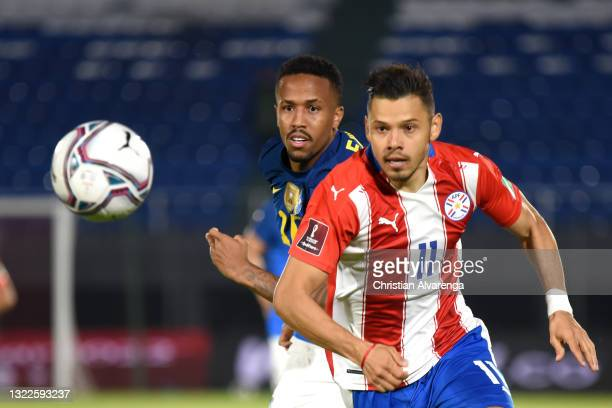 Ángel Romero of Paraguay competes for the ball with Eder Militão of Brazil during a match between Paraguay and Brazil as part of South American...
