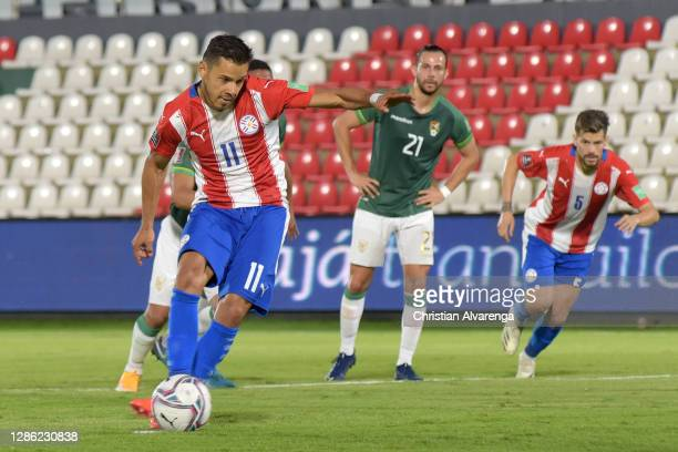 Ángel Romero of Paraguay kicks a penalty to score the first goal of his team during a match between Paraguay and Bolivia as part of South American...