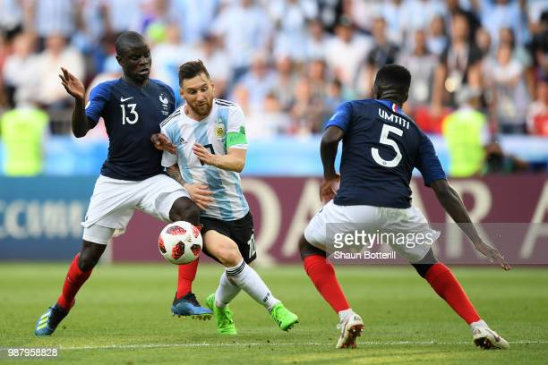Ngolo Kante and Samuel Umtiti of France put pressure on Lionel Messi of Argentina during the 2018 FIFA World Cup Russia Round of 16 match between...