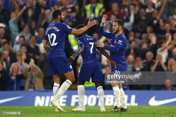 Ngolo Kante celebrates with Eden Hazard of Chelsea after he scores his sides first goal during the Premier League match between Chelsea FC and...