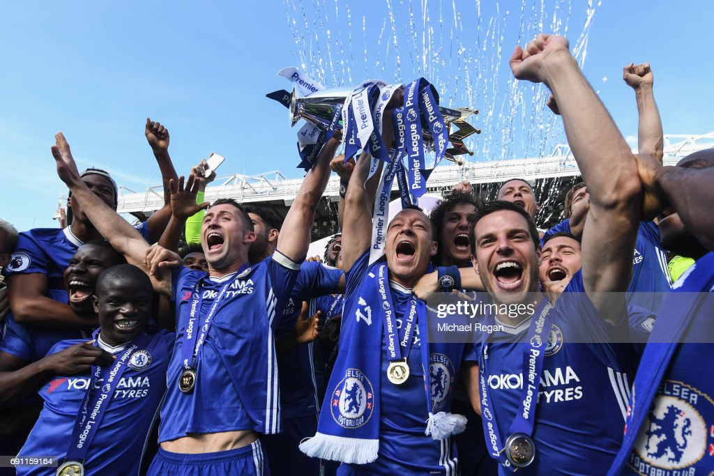 Ngolo Kante, Gary Cahill, John Terry and Cesar Azpilicueta of Chelsea celebrates with the Premier League Trophy after the Premier League match between Chelsea and Sunderland at Stamford Bridge on May 21, 2017 in London, England.