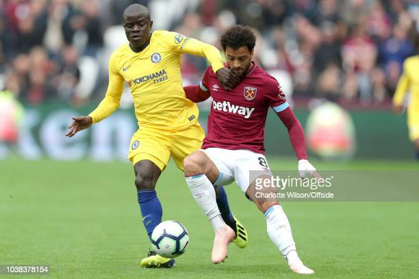 NGolo Kante of Chelsea and Felipe Anderson of West Ham battle for the ball during the Premier League match between West Ham United and Chelsea FC at...