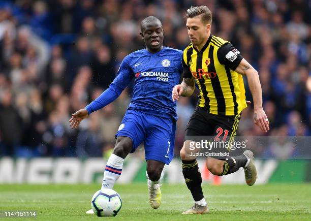 Ngolo Kante of Chelsea and Kiko Femenia of Watford in action during the Premier League match between Chelsea FC and Watford FC at Stamford Bridge on...