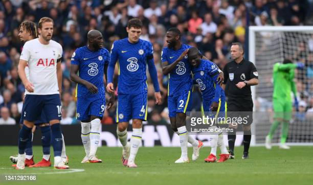 Ngolo Kante of Chelsea celebrates with teammate Antonio Ruediger after scoring their side's second goal during the Premier League match between...