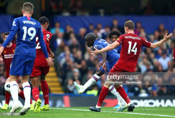 NGolo Kante of Chelsea FC scores his teams first goal during the Premier League match between Chelsea FC and Liverpool FC at Stamford Bridge on...