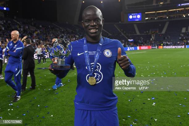 """Ngolo Kante of Chelsea poses for a photograph with the """"Player of the Match"""" award after the UEFA Champions League Final between Manchester City and..."""