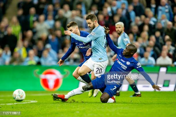 Ngolo Kante of Chelsea tackles Bernardo Silva of Manchester City during the Carabao Cup match between Chelsea and Manchester City at Wembley Stadium,...