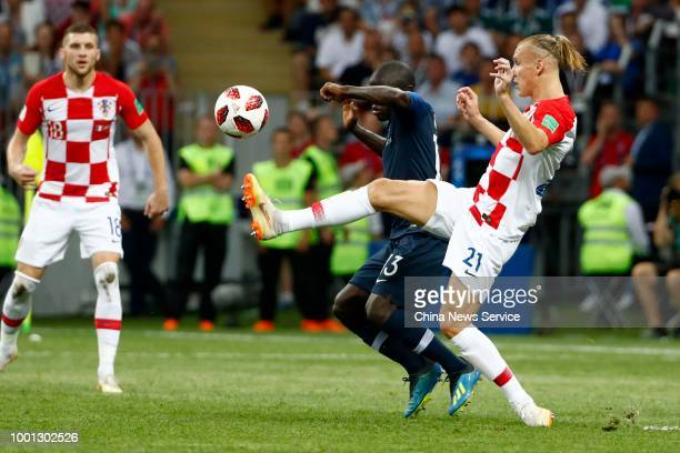 Ngolo Kante of France and Domagoj Vida of Croatia comepte for the ball during the 2018 FIFA World Cup Russia final match between France and Croatia...