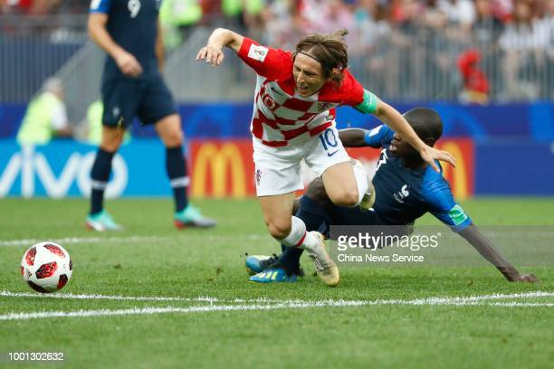 Ngolo Kante of France and Luka Modric of Croatia compete for the ball during the 2018 FIFA World Cup Russia final match between France and Croatia at...