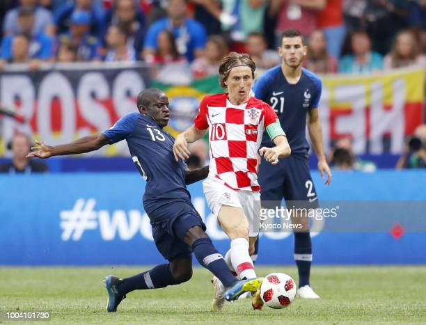 Ngolo Kante of France and Luka Modric of Croatia vie for the ball during the first half of the World Cup final at Luzhniki Stadium in Moscow on July...