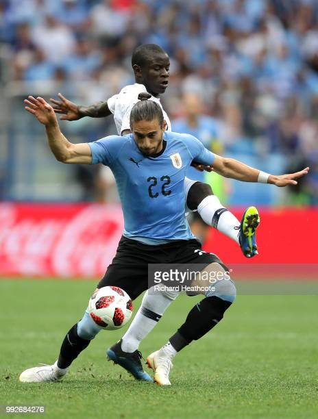 Ngolo Kante of France challenges Martin Caceres of Uruguay during the 2018 FIFA World Cup Russia Quarter Final match between Uruguay and France at...