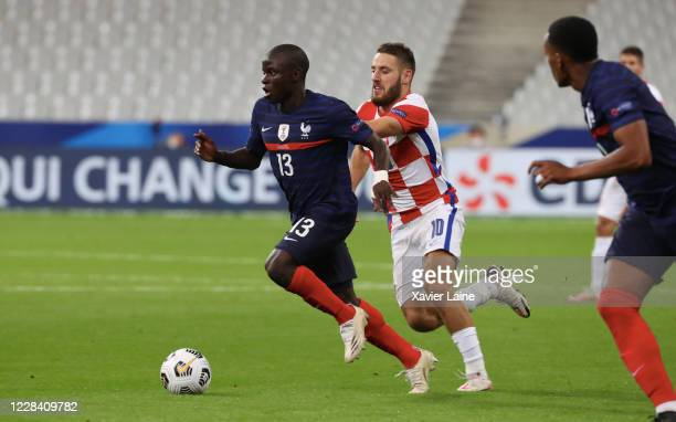 Ngolo Kante of France in action with Nikola Vlasic of Crotia during the UEFA Nations League group stage match between France and Croatia at Stade de...