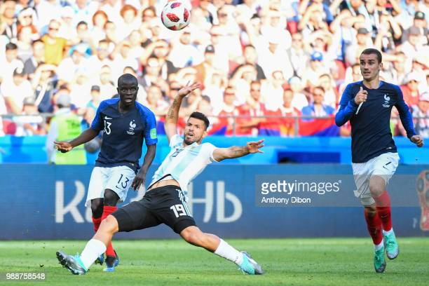 Ngolo Kante of France Kun Aguero of Argentina and Antoine Griezmann of France during the FIFA World Cup Round of 16 match between France and...