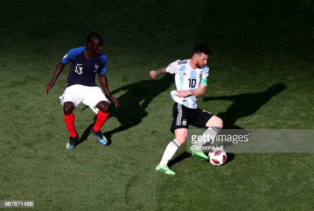 Ngolo Kante of France puts pressure on Lionel Messi of Argentina during the 2018 FIFA World Cup Russia Round of 16 match between France and Argentina...