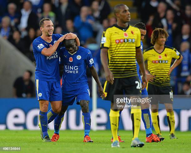 Ngolo Kante of Leicester City celebrates scoring his team's first goal with his team mate Danny Drinkwater during the Barclays Premier League match...