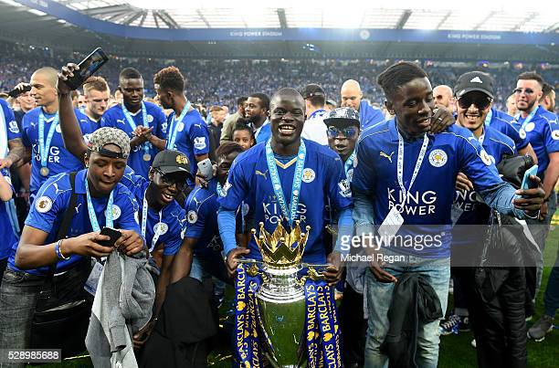 Ngolo Kante of Leicester City poses with the Premier League Trophy with his family as players and staffs celebrate the season champion after the...