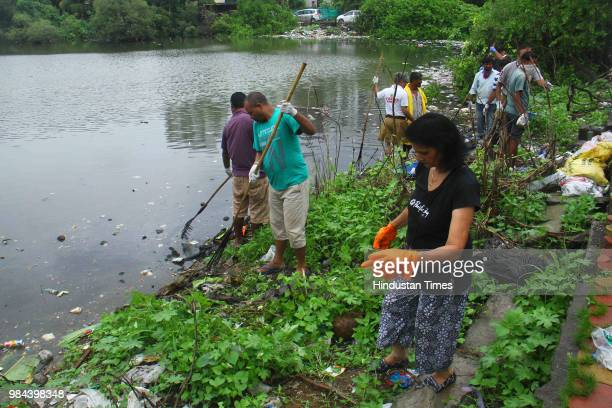 NGOs and Citizen Group join hands to remove trash from waterbody at Sector 8 Charkop Kandivali on June 24 2018 in Mumbai India