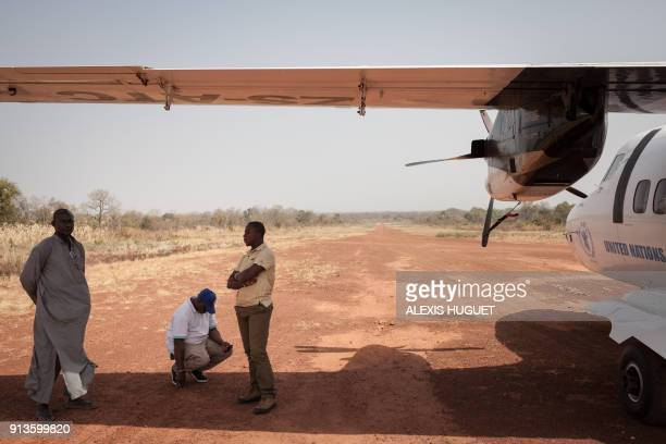 NGOs staffs wait to board a UN chartered plane at the Tiringoulou airport northern Central African Republic on December 22 2017 / AFP PHOTO / ALEXIS...