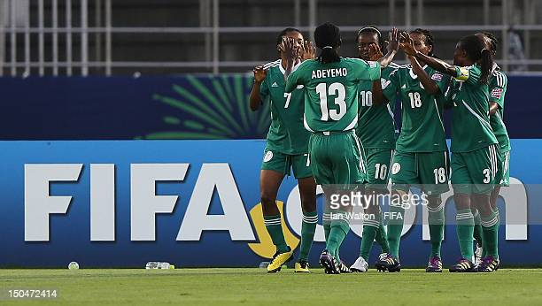 Ngozi Okobi of Nigeria celebrates scoring a goal with teammates during the FIFA U20 Women's World Cup Japan 2012 Group B match between Nigeria v...
