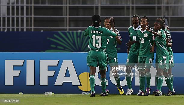 Ngozi Okobi of Nigeria celebrates scoring a goal with team-mates during the FIFA U-20 Women's World Cup Japan 2012, Group B match between Nigeria v...