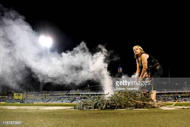 Ngunnawal elder Serena Williams performs a smoking ceremony during the round 15 Super Rugby match between the Brumbies and the Bulls at GIO Stadium...