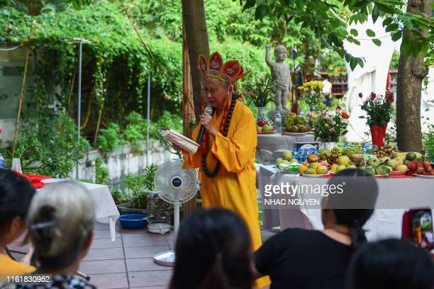 Nguyen Bao Sinh the owner of a cemetery for pets leads a prayer ceremony for dogs and cats at Te Dong Vat Nga pagoda which means all lives are equal...