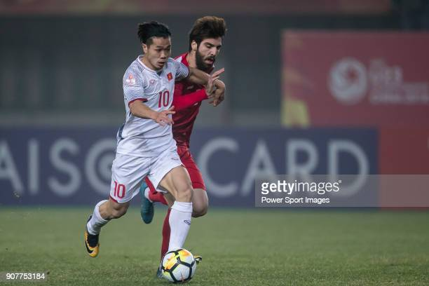 Nguyen Cong Phuong of Vietnam fights for the ball with Mohamed Arnaout of Syria during the AFC U23 Championship China 2018 Group D match between...