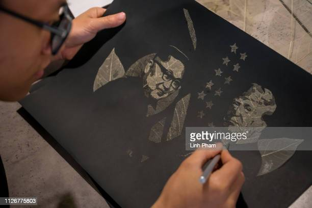 Nguyen Cong Toan cuts dried leafs to make portraits of US President Donald Trump and North Korean leader Kim Jongun in honor of the upcoming summit...