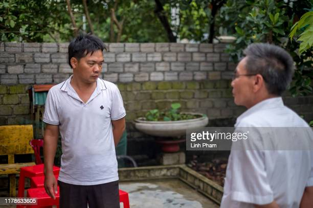 Nguyen Dinh Tinh and Nguyen Dinh Sat brother and father of Nguyen Dinh Tu believed to be one of the 39 victims found dead in a refrigerated truck in...