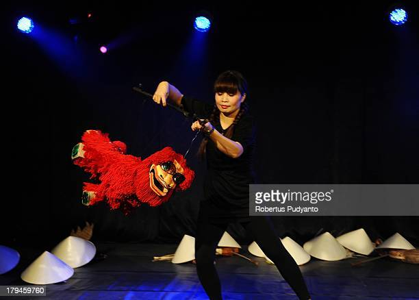 Nguyen Ho Thuy Tien of Vietnam Thank Long Water Puppet Theatre performs a solo show called 'Vietnam in Puppets' as part of the World Puppet Carnival...