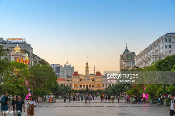 nguyen hue street in ho chi minh city, vietnam - people's committee building ho chi minh city stock pictures, royalty-free photos & images