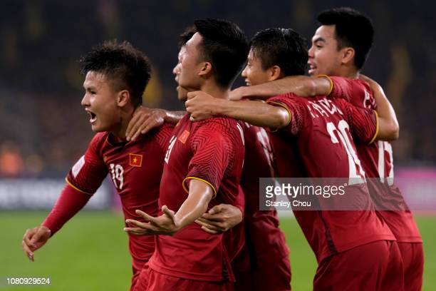 Nguyen Huy Hung of Vietnam celebrates with teammates their 1st goal during the AFF Suzuki Cup final first leg match between Malaysia and Vietnam at...