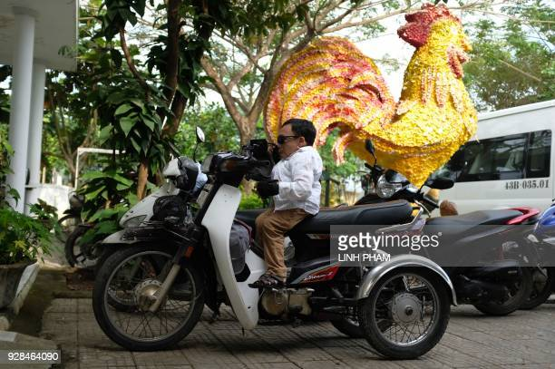 Nguyen Ngoc Phuong who suffers the affects of Agent Orange arrives on his motorycle at a centre for victims of the wartime defoliant during a visit...
