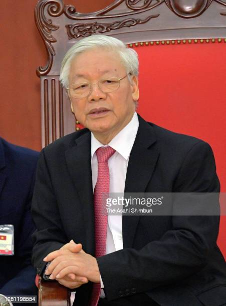 Nguyen Phu Trong, General Secretary of the Communist Party of Vietnam talks to Japanese Prime Minister Yoshihide Suga during their meeting at the...