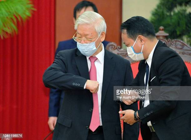 Nguyen Phu Trong, General Secretary of the Communist Party of Vietnam practices elbow bump prior to his meeting with Japanese Prime Minister...