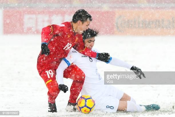 Nguyen Quang Hai of Vietnam and Jasurbek Yakhshiboev of Uzbekistan compete for the ball during the AFC U23 Championship China 2018 final match...