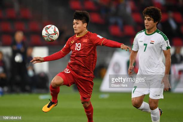 Nguyen Quang Hai of Vietnam and Safaa Hadi AlFuraiji of Iraq compete for the ball during the AFC Asian Cup Group D match between Iraq and Vietnam at...