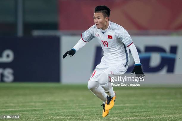 Nguyen Quang Hai of Vietnam celebrates after scoring his goal during the AFC U23 Championship China 2018 Group D match between South Korea and...