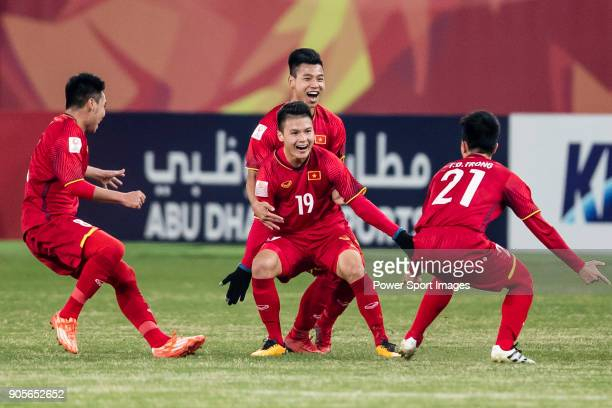Nguyen Quang Hai of Vietnam celebrates after scoring his goal with his teammates during the AFC U23 Championship China 2018 Group D match between...