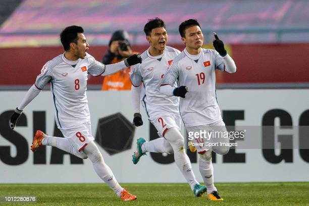 Nguyen Quang Hai of Vietnam celebrating his goal with his teammates during the AFC U23 Championship China 2018 Semi Finals match between Qatar and...