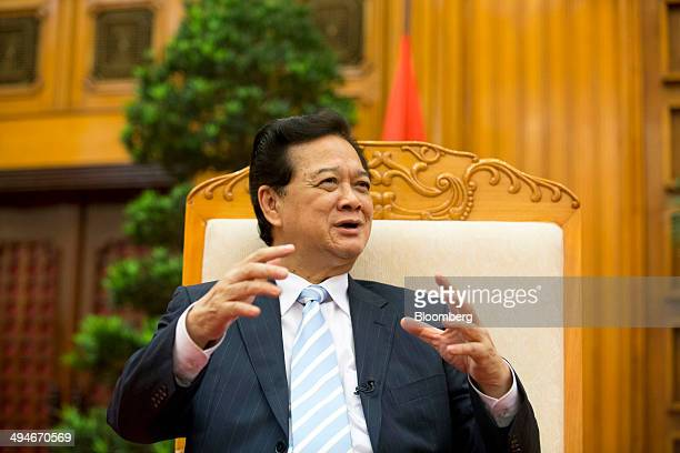 Nguyen Tan Dung Vietnam's prime minister gestures while he speaks during an interview in Hanoi Vietnam on Friday May 30 2014 Vietnam has prepared...