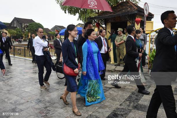 Nguyen Th Hien wife of Vietnams President Tran Dai Quang walks during a spouses tour in the central Vietnamese town of Hoi An on November 11 as...