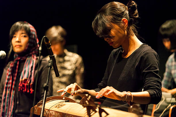 Nguyen Thuy Dung of the German Vietnamese band HanoiBerlin plays a traditional Vietnamese instrument Dan Tranh at Jazzhouse during the second day of...