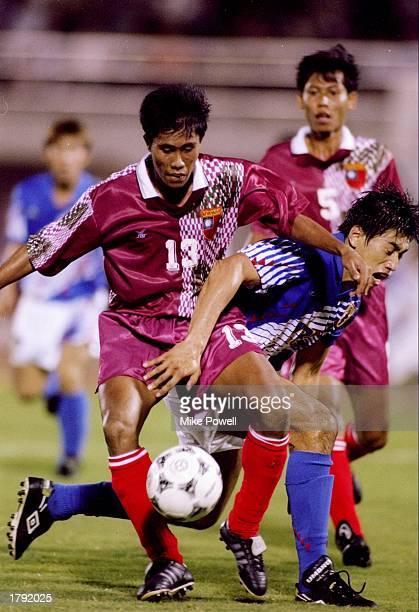 Ngwe Tun of Malaysia runs over Takuya Takagi of Japan at the Asian Games in Hiroshima, Japan. Mandatory Credit: Mike Powell /Allsport